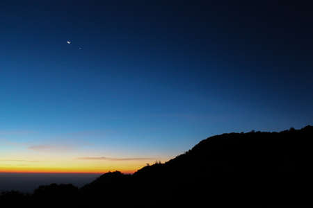 reveille: Silhouette mountain with sunrise sky stratosphere background - Landscape, background Stock Photo