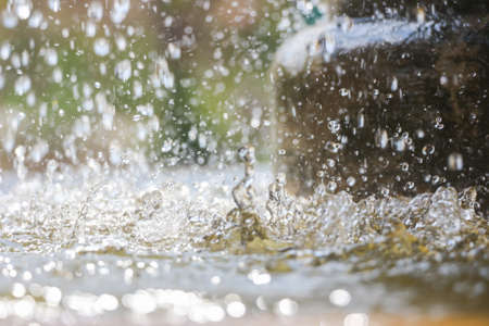 freshening: Close up of water drops in the public fountain  - Macro, soft focus Stock Photo