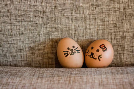 sackcloth: Funny easter rabbit eggs, lover eggs couple, Face drawing on eggs in sackcloth background