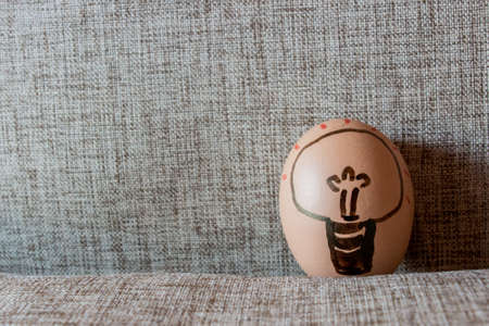 sackcloth: Idea Easter egg, Bulb drawing in egg with sackcloth background