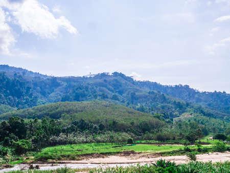 Mountain, river, and blue sky in Lansaka, Nakhon Si Thammarat, Thailand. Beautiful green landscape. Reklamní fotografie