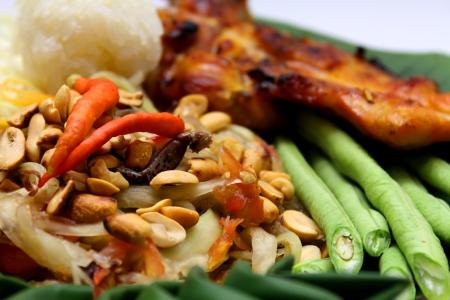 Green Papaya Salad put Salted Crab and Roasting Chicken Stock Photo