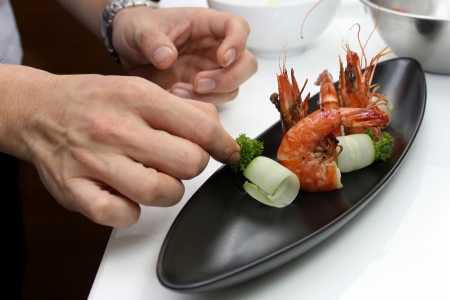 Chef cooking menu Pan Fried Tiger Prawn with Curly Cucumber