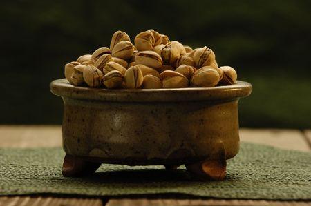 Pistachios in a bowl Фото со стока