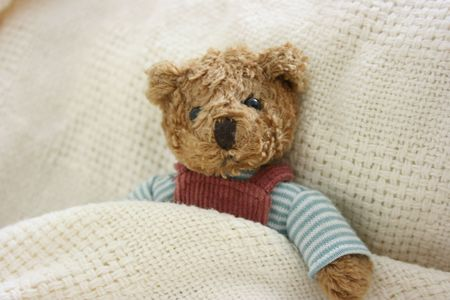 Toy bear resting in bed Stock Photo - 2553901