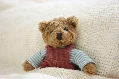 Toy bear wake up from sleep Stock Photo - 2553917