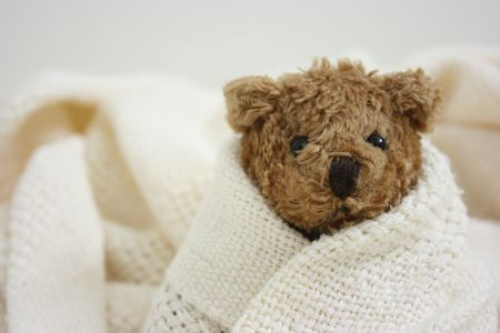 Toy bear is sick, close-up Stock Photo