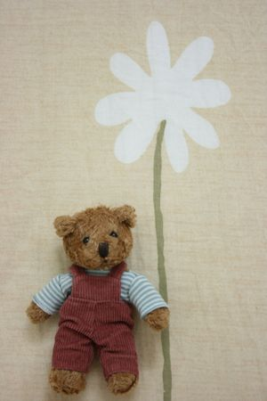 Toy bear holding flower Stock Photo