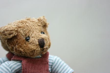 Toy bear leaning against a mirror,close-up Stock Photo