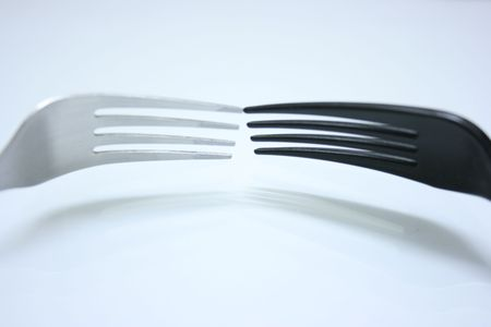 Forks facing each other,close distance Stock Photo