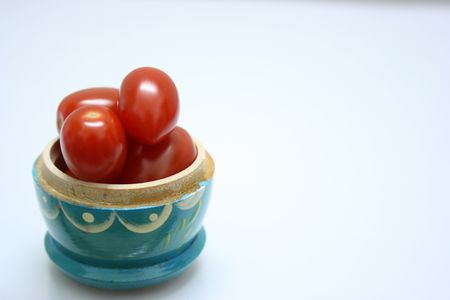 Tomatoes in a blue case Stock Photo