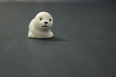 facing the camera: White toy seal facing camera