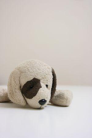 Stuffed toy dog lying Stock Photo