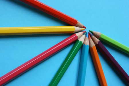 Color pencils pointing to a target