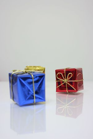 Three presents in shiny wrapper,christmas ornament photo