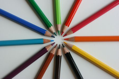 Color pencils pointing to the center