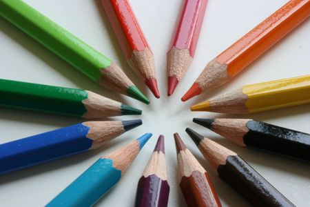 Color pencils pointing to the same point photo
