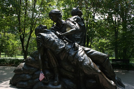 Washington DC,USA, July 22,2010 – Vietnam Veterans Memorial, Bronze statue of wounded soldier and nurse
