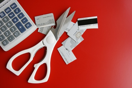 bank records: Cut credit card,scissors and calculator