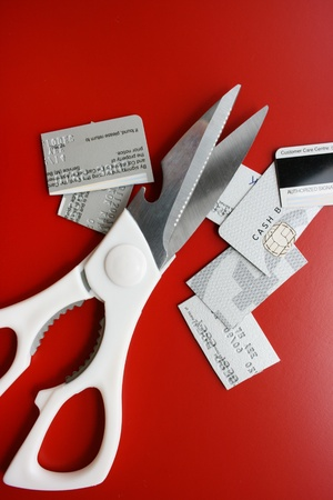 Scissors and cut credit card photo