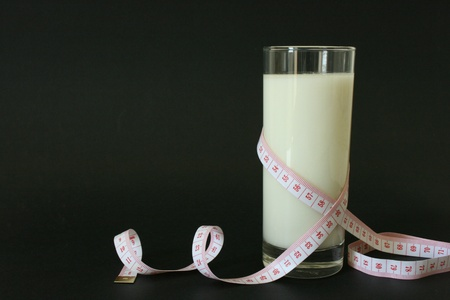 A glass of milk and body measuring tape Stock Photo