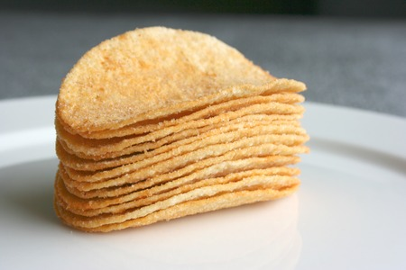 A stack of potato chips, close up