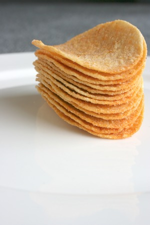 Potato chips stacked up Stock Photo