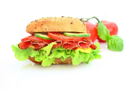 Fresh sandwich with salami cheese and vegetables photo