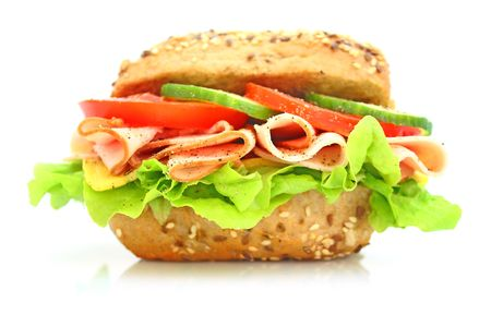 Fresh sandwich with ham and cheese and vegetables photo