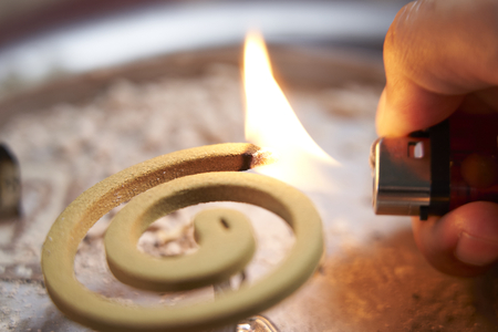 Mosquito repellent has burning by lighters. Have fume and smelly. Dengue Prevention. Stock Photo