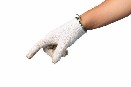 Human hand is wearing mechanic gloves showing gesture push button on isolated background.