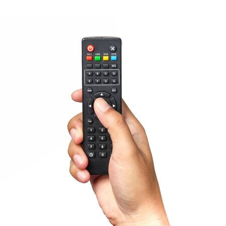 Hand is holding television remote control and pressing buttons isolated on white background. Stok Fotoğraf