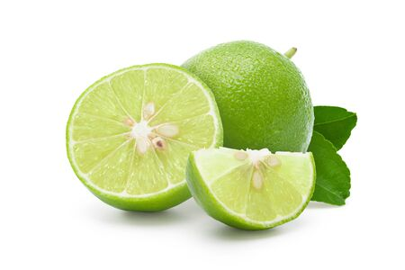 Fresh lime with leaf, and seeds isolated on white. Clipping path, Full depth.