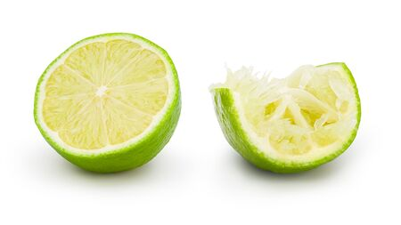 Fresh lime cut in half with drop shadow on white background. Commercial image of citrus fruits isolated with clipping path. Standard-Bild