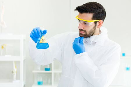A medical scientist is researching and experimenting for effective biological chemicals and reactions for the production of vaccines against and treat a disease within the laboratory.
