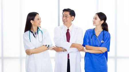 Three medical personnel standing arms crossed together and smiling. Portrait of successful teams of doctors in the hospital. 免版税图像 - 150259256