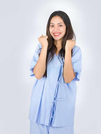 Women wearing patient clothes showing confident gestures.