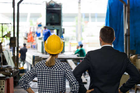 Female engineer is listening to recommendations for the qualifications of the machines ordered into the factory. The manager was talking to the technician about the delivery product to the customer.