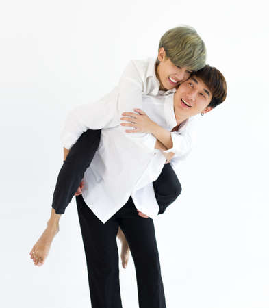 Happy Asian men or couples are embracing together isolated on white background. LGBTQ concept.