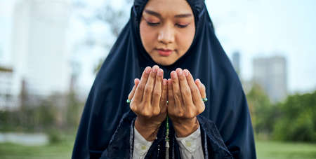 Muslim women are doing salah to pray to Allah.