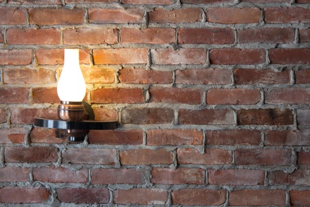 wall sconce: Old-fashioned sconce light on a brick wall