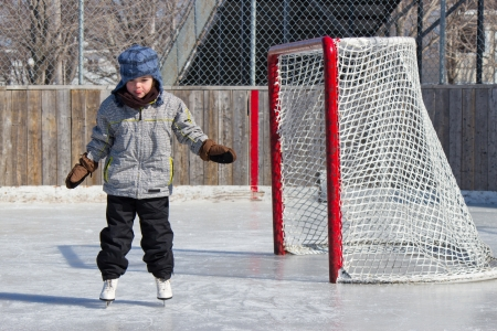 canada day: Little girl skating at an outdoor skating rink