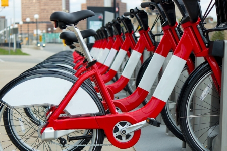 A row of red rental bicycles