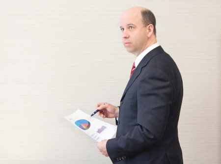 Business man holding a document. photo