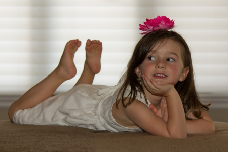 little girl barefoot: Beautiful, happy child posing Stock Photo