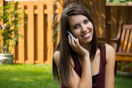 A pretty girl talks on her mobile phone. photo