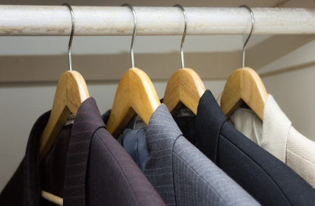 closet: Business suits in the closet  Stock Photo
