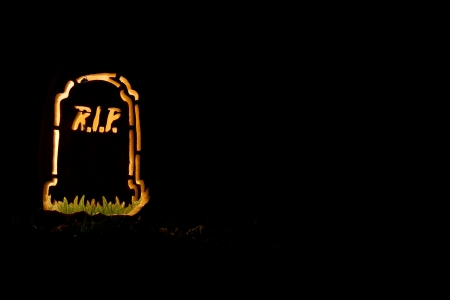A Halloween tombstone made from a pumpkin  photo