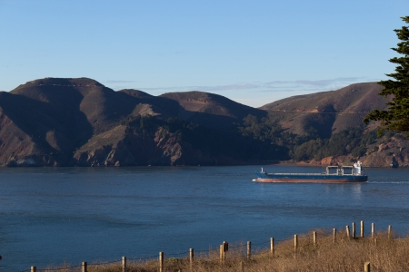 Cargo Ship near the coastline photo