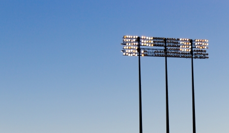 Stadium lights over a blue sky Banco de Imagens